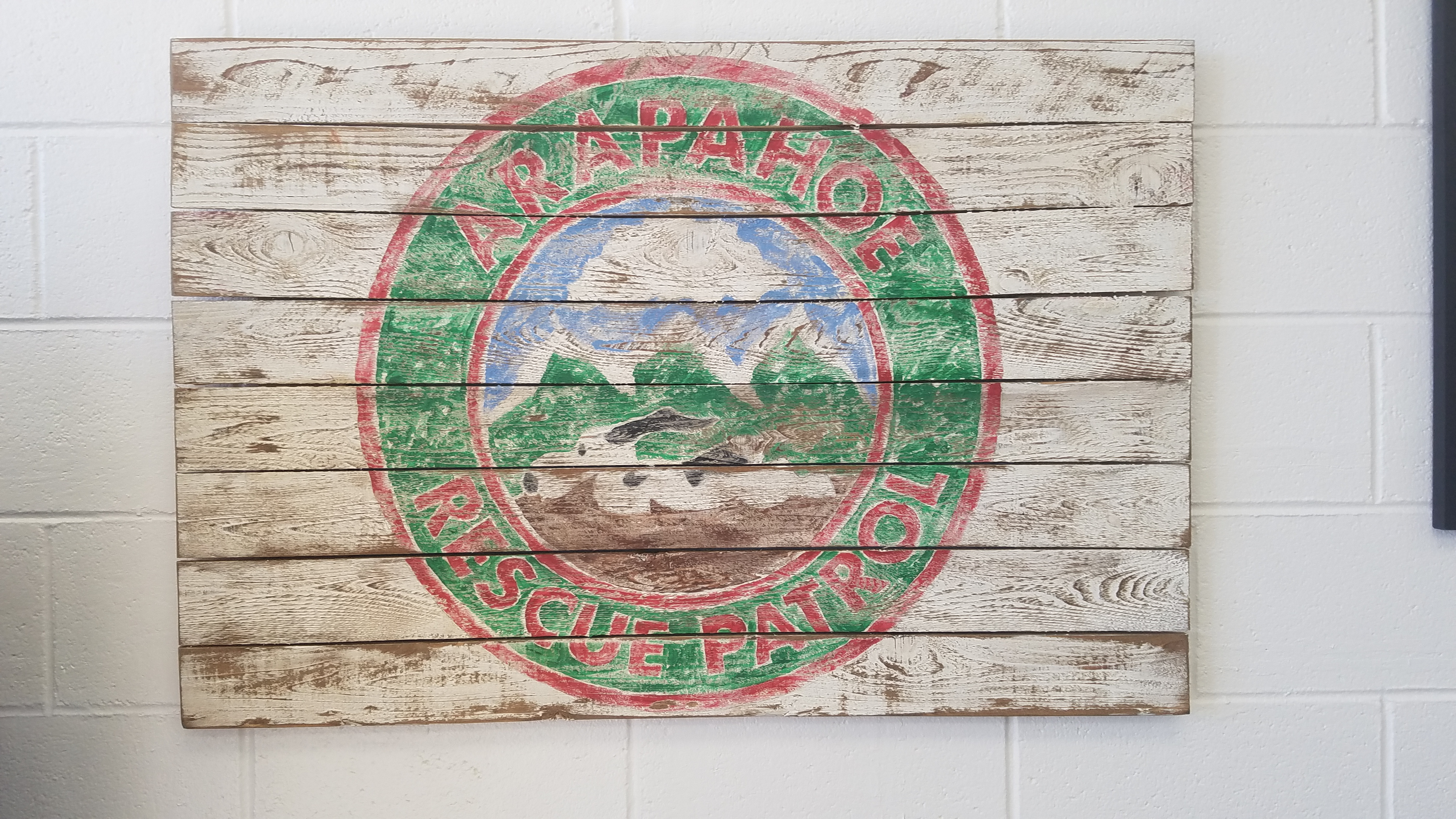 We were high bidder on this cool painted sign of the Arapahoe Rescue Patrol Logo.