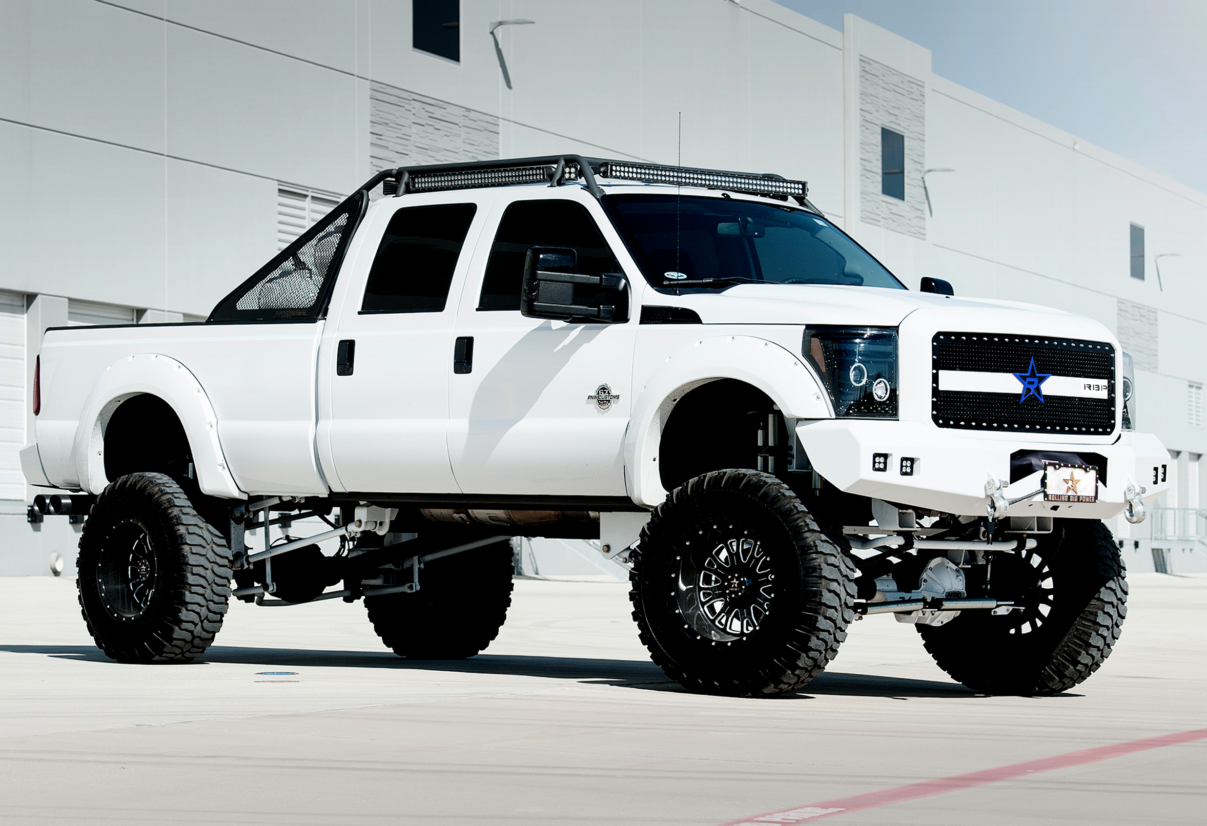 Lifted full size white Ford 4x4