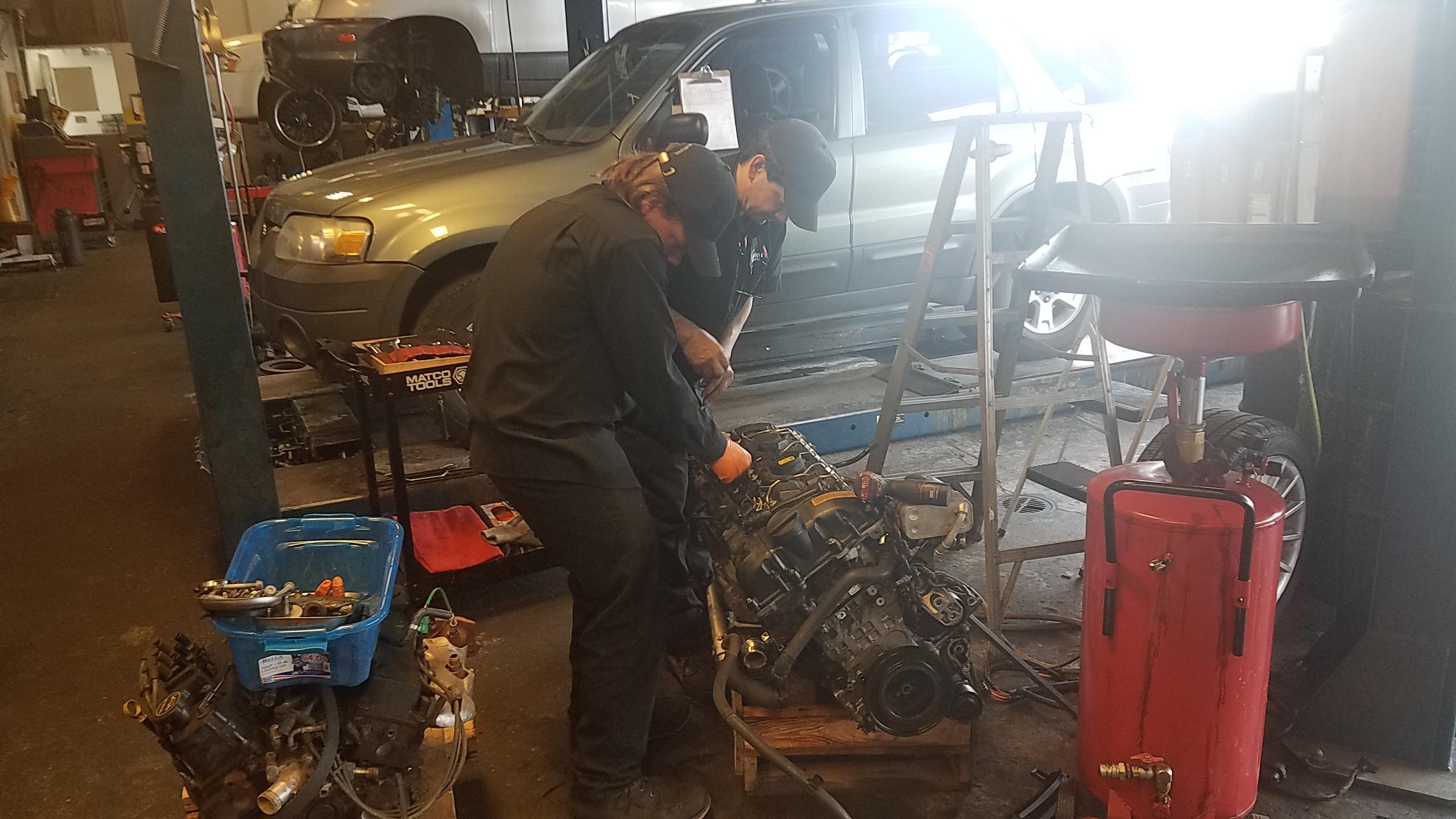 Teamwork on an engine.